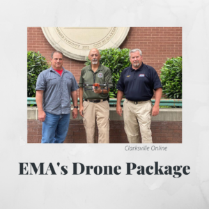 GIS Project Manager Doug Catellier stands with two members of the EMA. One EMA member holds a drone.